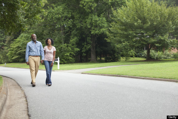 African American couple walking together on road